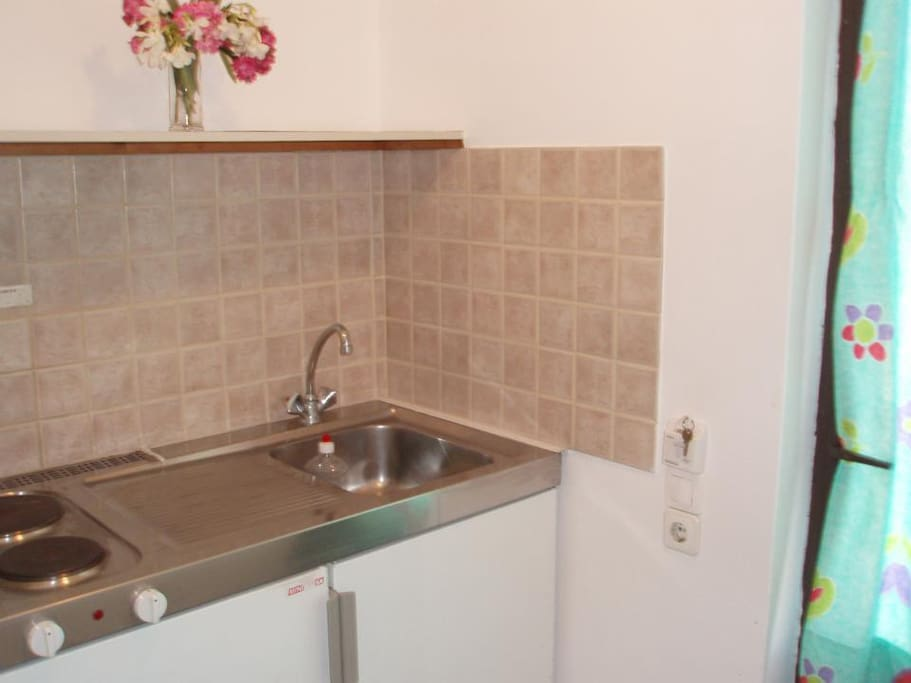 Private small kitchen with  pans, frying pans, dishes, cups,forks ,Kettle, sandwith.