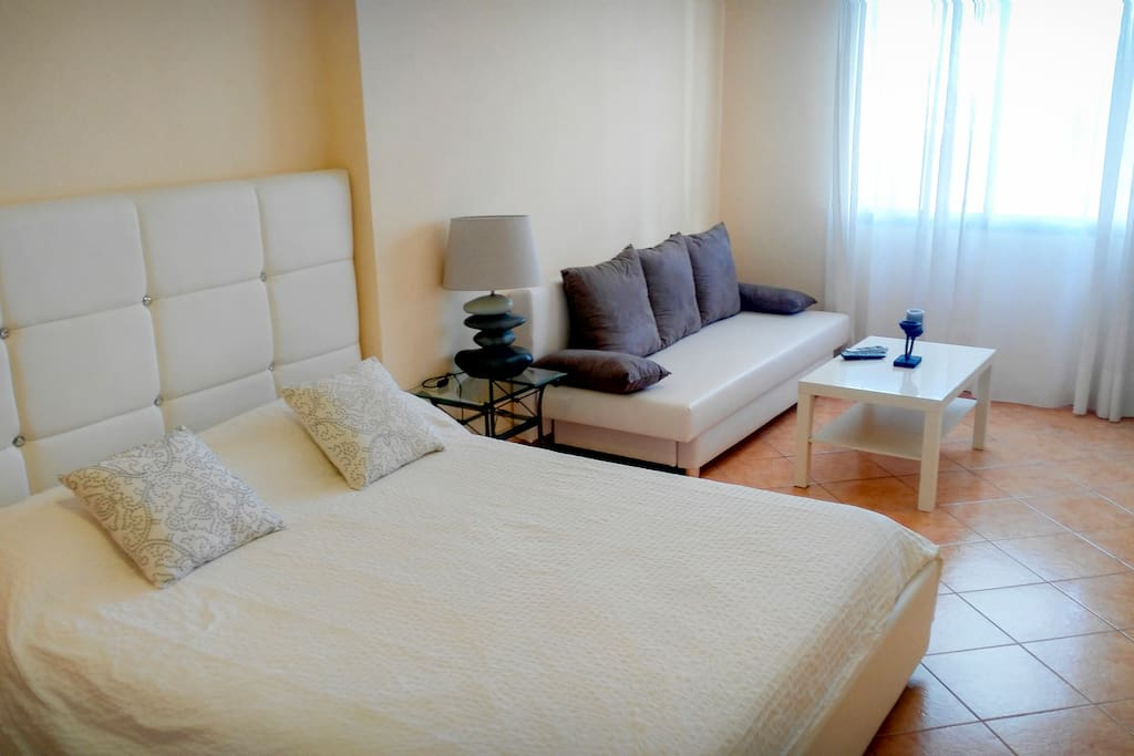 Master bedroom with high quality matress, Safe, Sat TV ( Astra ), walk in closet, double Sofa bed, garden view