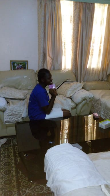 Daughter Parvin in the living room watching television