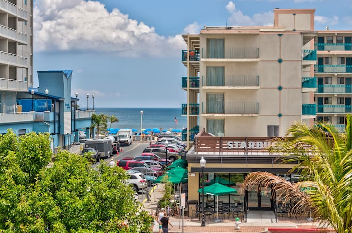 Peek-a-boo oceanview condo w/ shared pool & prime location 1 block from beach!
