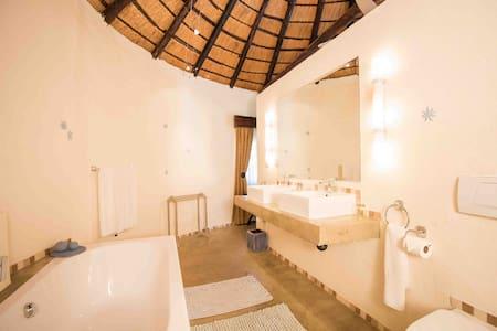 Mziki Safari Lodge - Rondavel Rooms