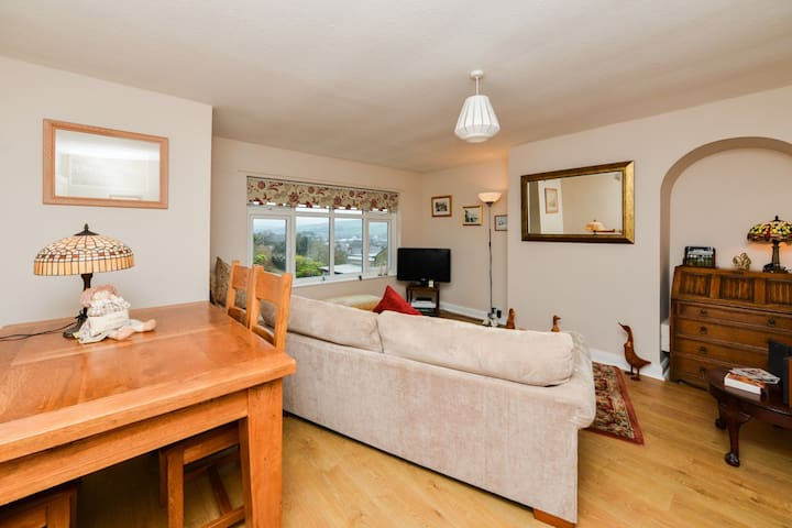 Shared lounge with TV with a view to remember with dining table and chairs
