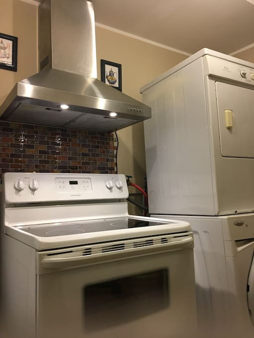 An oven with a fan to facility any cooking needed. A washer and a dryer at your disposal - right in the kitchen.