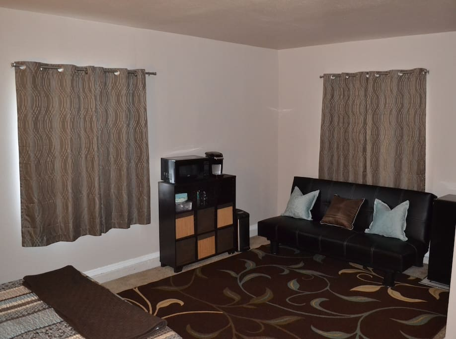 Sitting area, with microwave & coffee maker.  Complementary   coffee & tea supplies and basket of snacks provided.