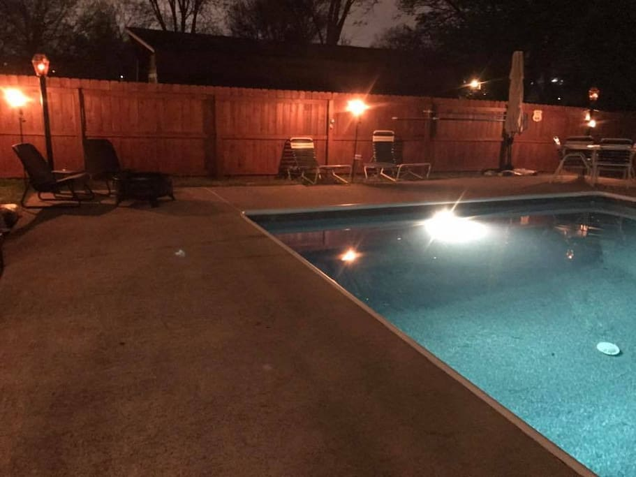 Pool @ night with Tiki Torches and ample seating