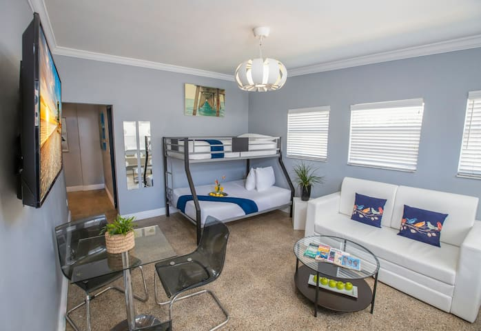 Sweet Suites One Bedroom Accommodations with Queen Bed, Bunk Bed, and Kitchen, Just Steps from the Beach
