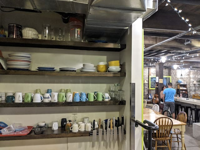 Fully-stocked community kitchen with complimentary coffee and tea.
