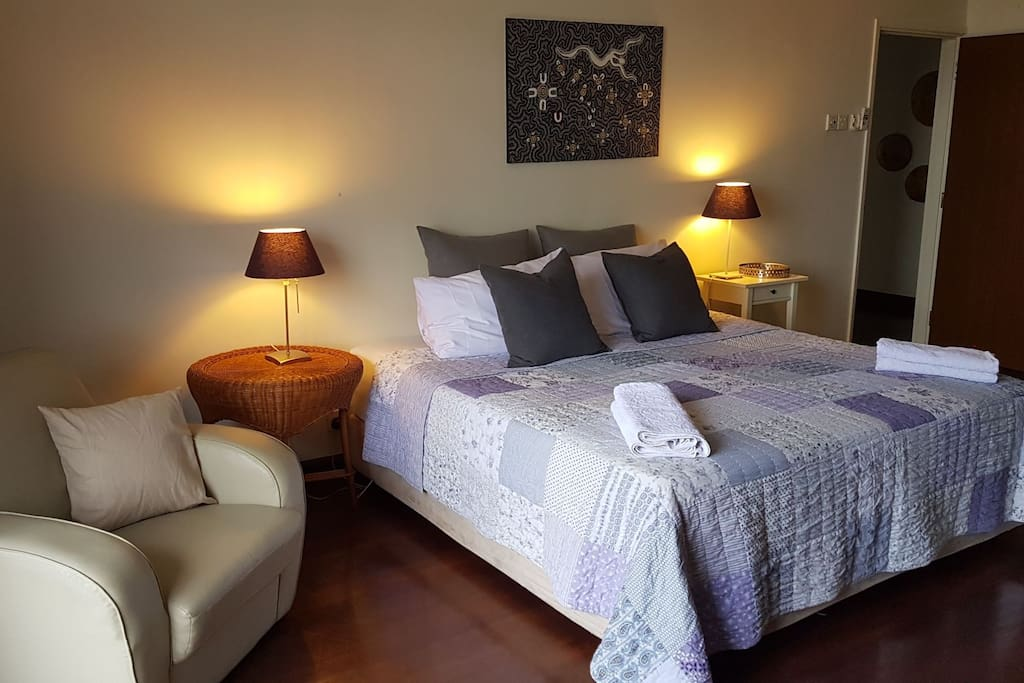 king size bed with quality bedding and wool underlay in large master bedroom