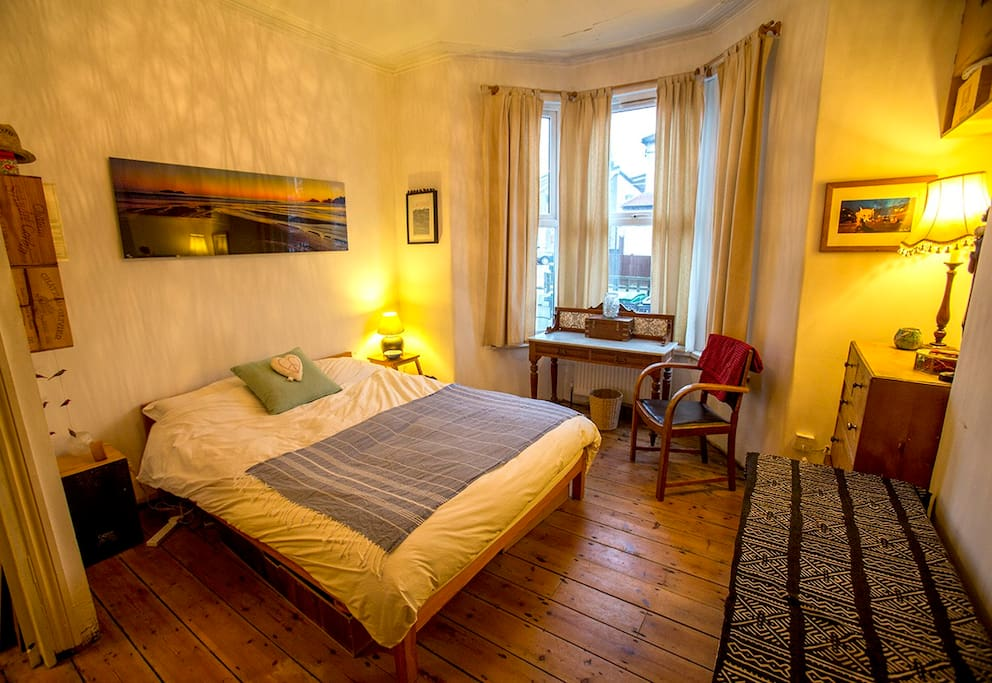 Lovely double bedroom with a Victorian bay window and original floorboards
