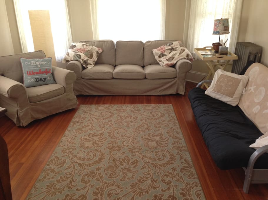 Living room space offers comfortable seating and a queen futon.