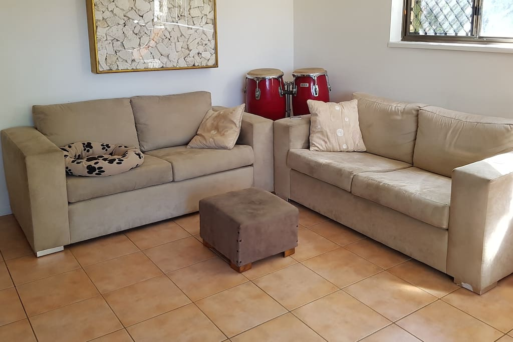 Comfortable lounge room with full sound system and 42in TV