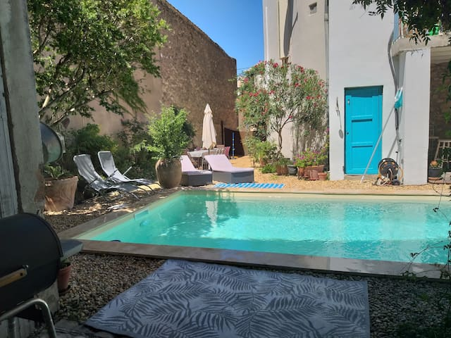 Holiday home with pool in a lively village Magalas