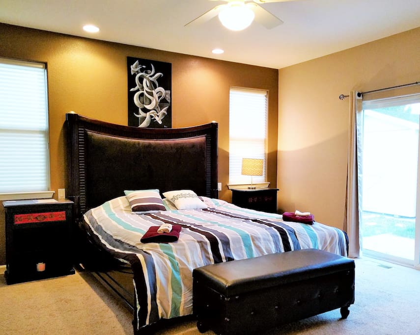 """Master Bedroom with Cal King size bed has its own private bathroom and walk-in closet. Also, direct access to the backyard.   Capacity is 4 guests with airbed set up. Look at my other listings to book separately. No desk inside room though.  Pam Said, """"Shandor 's house is really nice and clean. Everything is well organized and very informative. The bedroom is really nice and clean. The bed is very comfortable. It is very privacy for me."""" Check out my over 200 reviews."""