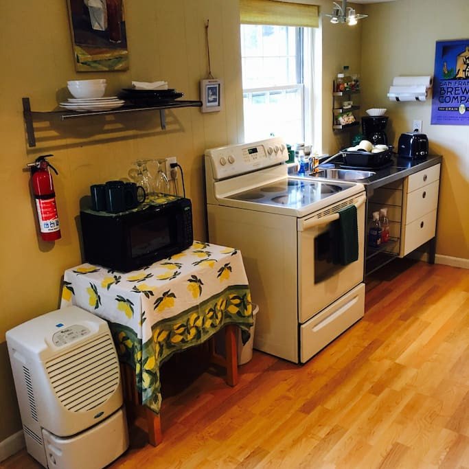 Fully equipped kitchenette with fridge and W/D (not pictured).  Breakfast items provided for stays of less than a week.