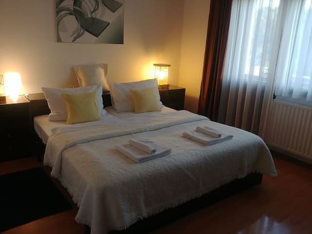 Bedroom with double bed and balcony, satellite TV