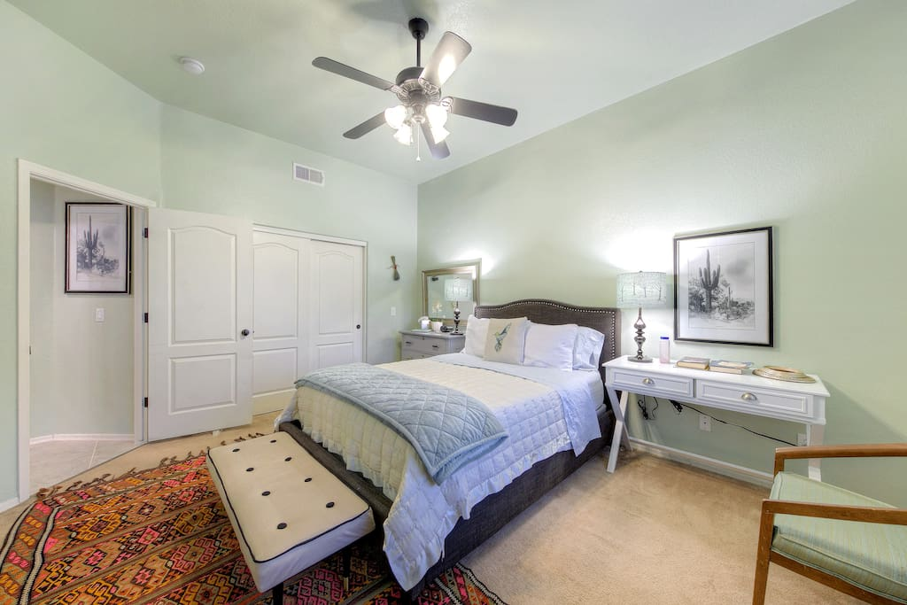 Tall ceilings and pale paint make the master bedroom extra peaceful.