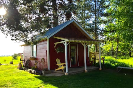 Cozy, country, studio style bungalow on 13 acres.