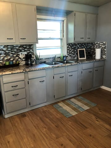 The kitchen area. We provide silverware, plates, toaster oven and coffee!
