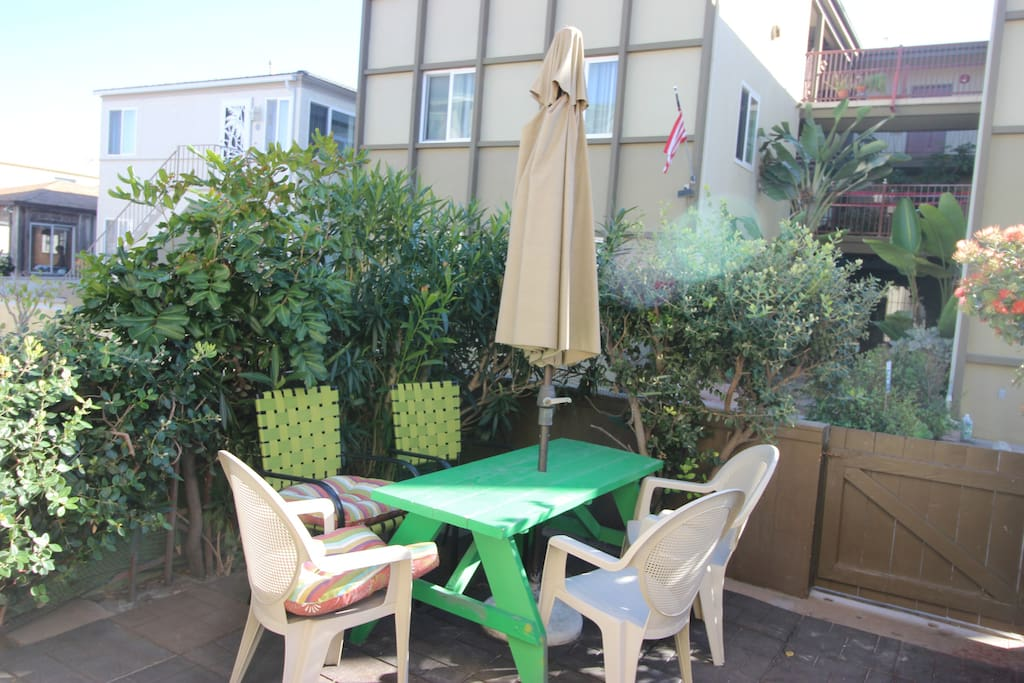 Outside patio with gas grill and patio seating! Just steps to the beachfront!