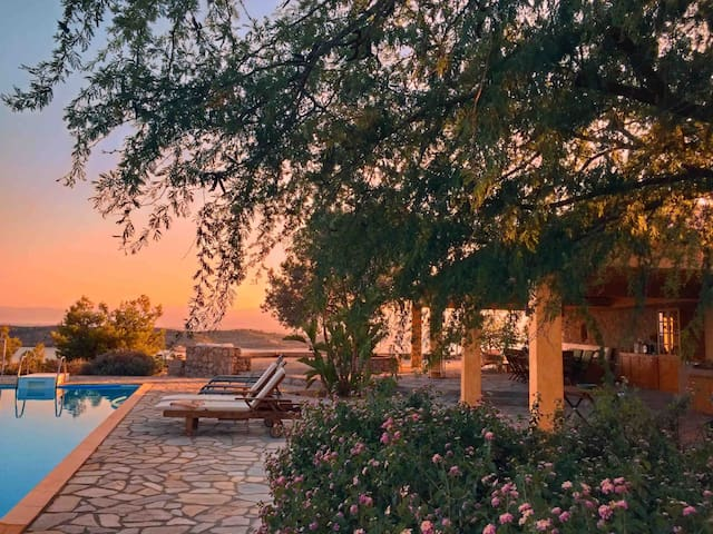 Swimming pool-Barbeque-Dining area-Garden-Sunset