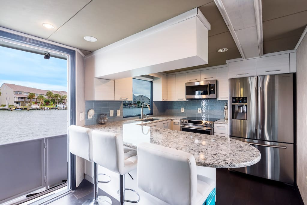 Remodeled galley with granite countertops including large dishwasher & full size convection oven microwave & coffee maker. Galley stocked with pots & pans, cutlery, bar & glassware.