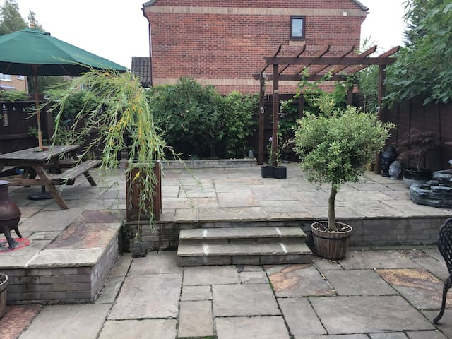 large patio area with plenty of seating and bbq / hammock facilities