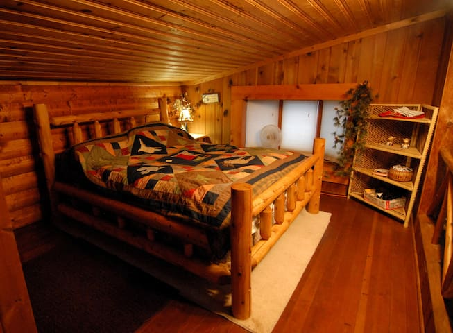 Lofted guest bedroom.