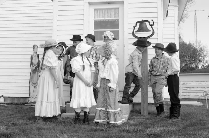 """Pure Nebraska"" visited Center School and did a news story on the 1892 school building.  (Students wait for the school bell to ring - to begin what will simulate a school day in the late 1800s.)"