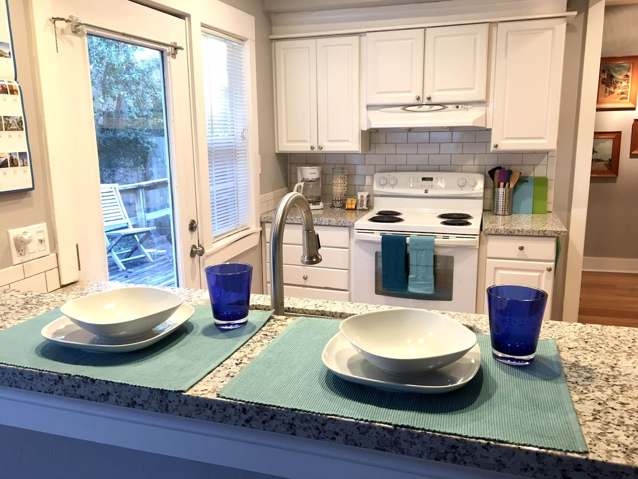 Modern and fully equipped kitchen with granite countertops.