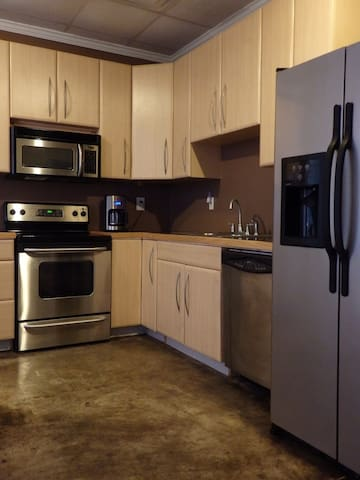 Kitchen complete with glass top stove, dishwasher, and very large refrigerator!