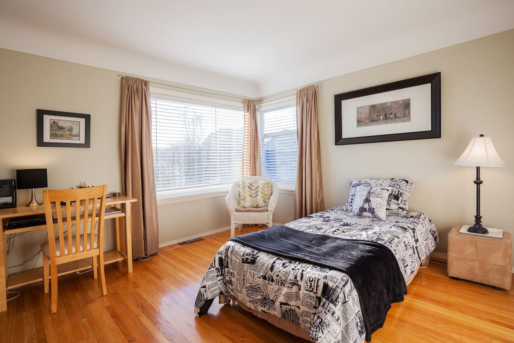 Large main floor bedroom with queen size bed and room for single air mattress or crib.
