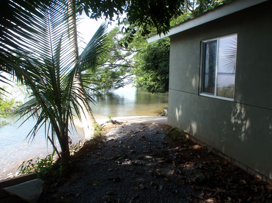 Path that leads off the boat ramp, past the attached boat garage.