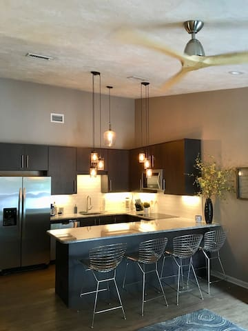 All new cabinets, appliances and dishes. Granite counter tops.