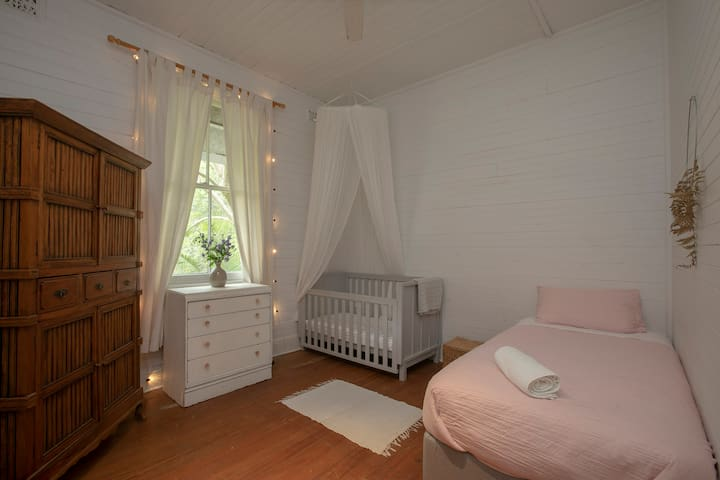 As well as a kids room with a cot and single bed