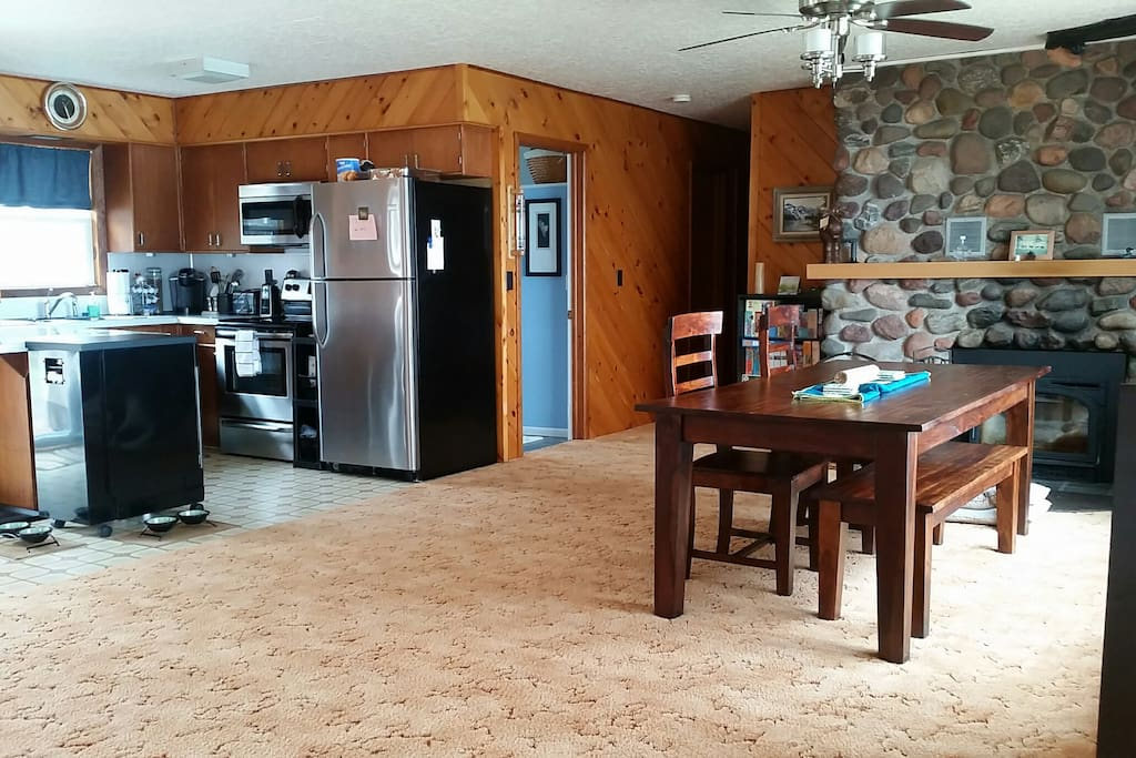 Kitchen and dining area. Stainless appliances include dishwasher