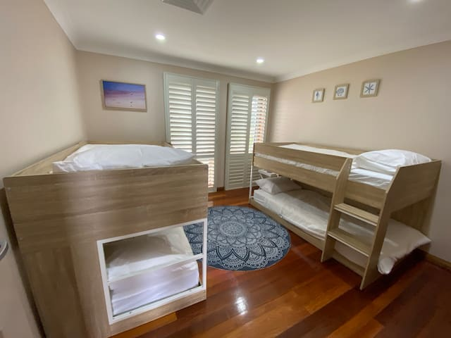 Bedroom four includes two bunk beds that sleep four, and a walk in wardrobe