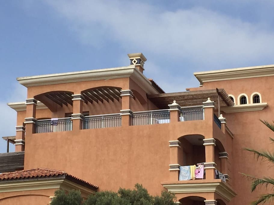 Top Floor Balcony equiped with barbeque area and outdoor patio furniture