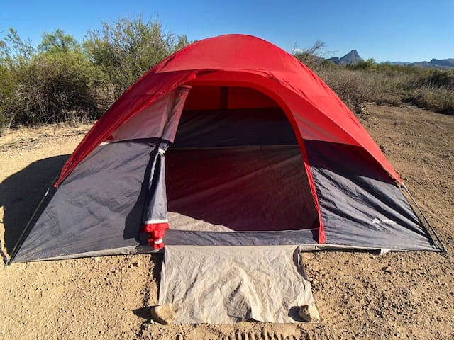 The tent can sleep two comfortably and includes a rainfly to keep you dry during the rare desert shower. You're welcome to bring your own tent too if you'd prefer that.