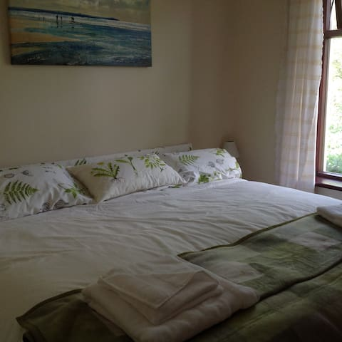 Wide double bed in bedroom or could be made into 2 single beds.