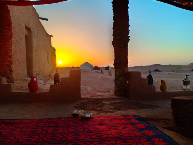 Enjoy the amazing desert sunset while you are at the camp