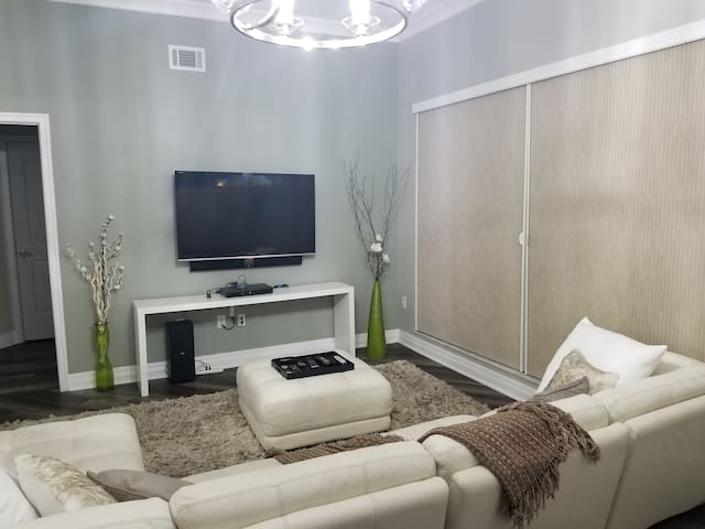 """Living room has 70"""" tv, TiVo, Wifi, and all premium cable channels with the exception of Starz"""