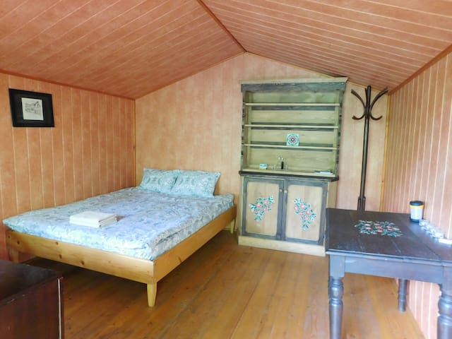 Double bed in Wood House No. 1