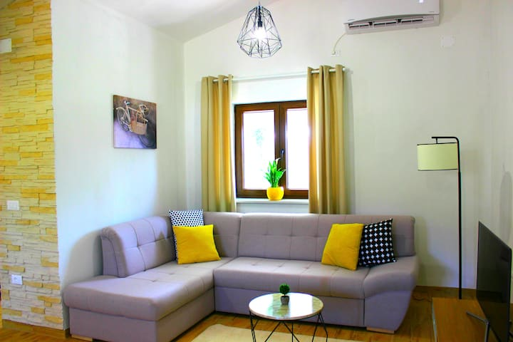 Spacious and comfortable sitting area with air conditioning and multimedia devices