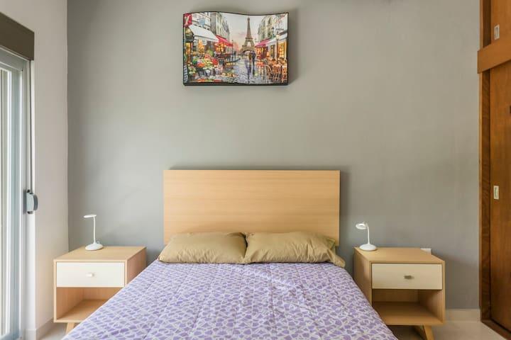 Dos habitaciones con camas matrimoniales