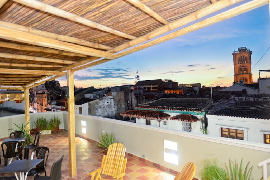 Amazing roof deck with bamboo shade cover & fans -- makes it great during the day or evening!