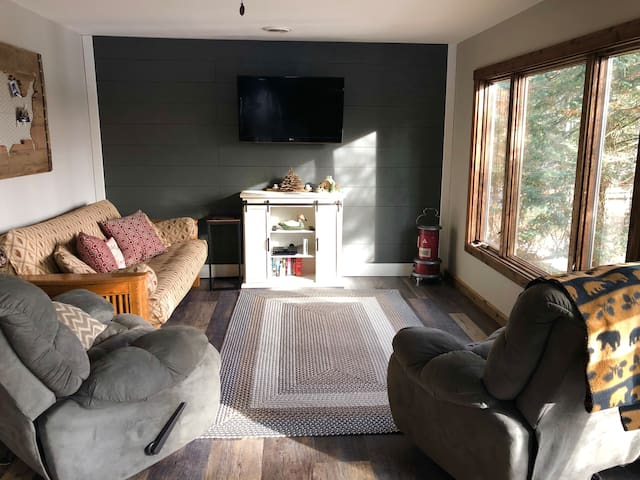 Natural lighting abounds bringing the outdoors in.  New remodeled living room with lots of windows for natural light and perfect views of all that nature offers.