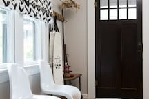 There is a coat rack as well as additional seating by the front door.