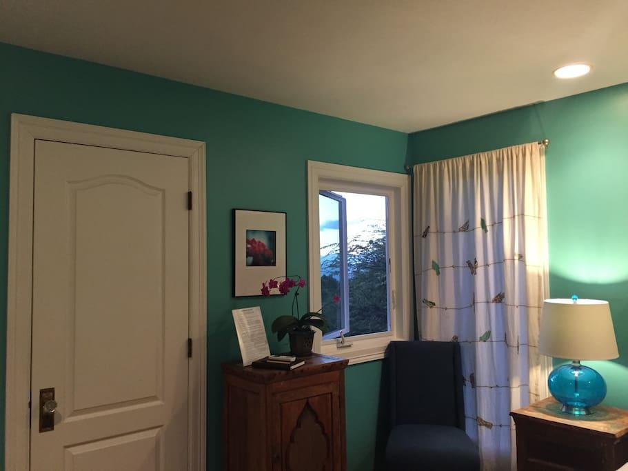 Another view of the bedroom/door to the bathroom.