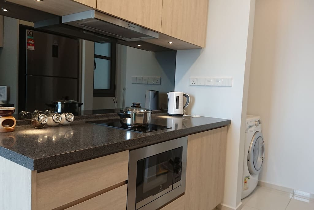 Full kitchen facilities (Cooking Hob + Hood, Microwave Oven, Kettle, Refrigerator, Washing Machine + Dryer in One)