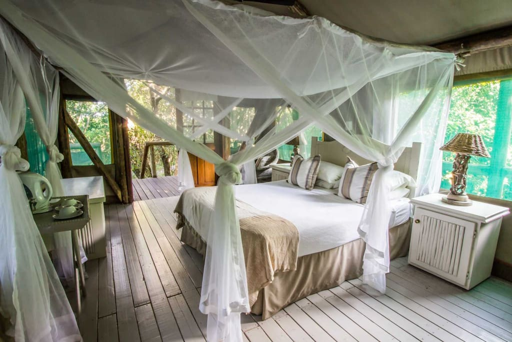 The tent has mosquito net, kettle, bedside lamps, safety deposit box and en suite bathroom with hot water